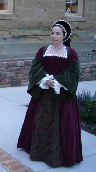 Reproduction Tudor Henrician Burgandy and Olive Lady's Gown. Photo and hat by Cate Jinemman.