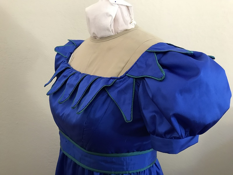 Reproduction 1820s Blue Dress with Van Dyke Points Bodice Left Quarter View.