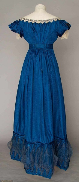 Augusta Auctions:COBALT SILK EVENING GOWN, 1820s Figured cobalt blue silk, empire bodice w/ laced V front satin panel, short cap sleeves, Lille lace trim, inset waist band, mesh puff hem trims. Back