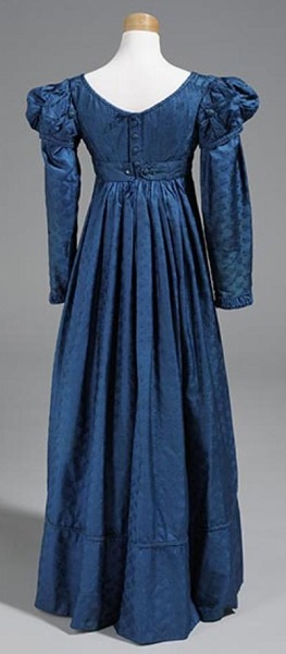 1824 Woman's royal blue brocade; empire waist; round neck; puffs at top of sleeves; belted at waist; center back opening. A separate pair of long sleeves (A-B) are also in royal blue brocade. North Carolina Museum of History