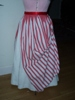 Reproduction 1887 red stripe bustle overskirt: back view