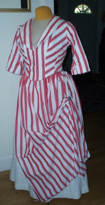 Reproduction 1887 Red Stripe Bustle Dress.